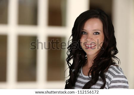 Teenage girl portrait while in her home