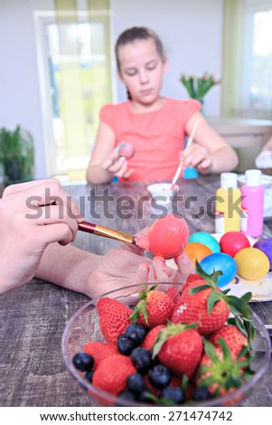 teenage girl preparing eggs for Easter at home - stock photo