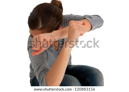 teenage girl protect herself with arms crossed in front of face - stock photo