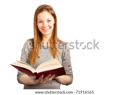 Teenage Girl Reading a Book and Smiling - stock photo