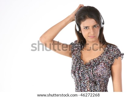 Teenage girl relaxing listening to music - stock photo