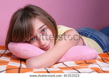 Teenage girl resting on the bed - stock photo