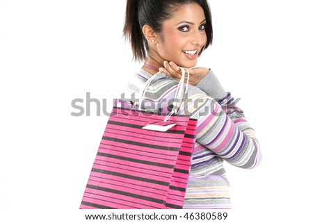 Teenage girl returning from shopping with bags - stock photo