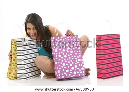 teenage girl seeing all her shopping bags happily - stock photo