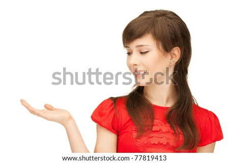 teenage girl showing something on the palm of her hand - stock photo