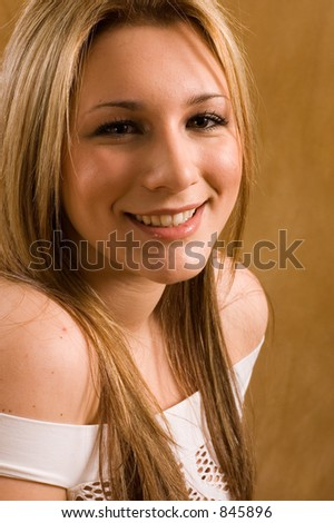 teenage girl smiling and laughing.