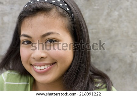 Teenage girl (13-15) smiling, portrait, close-up