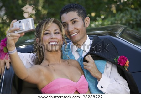 Teenage Girl Snapping Photo at Prom - stock photo