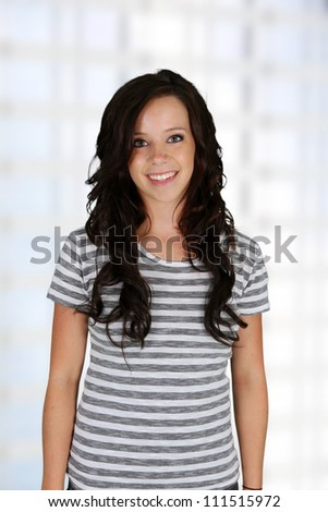 Teenage girl standing up in her home - stock photo