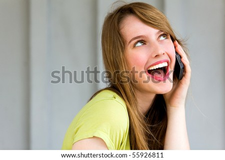Teenage girl talking on a mobile phone - stock photo