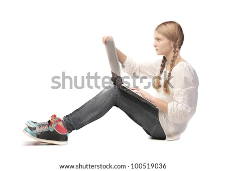 Teenage girl using a laptop - stock photo
