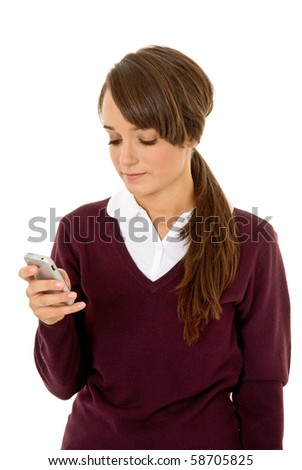 Teenage girl using phone isolated on white - stock photo
