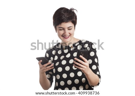Teenage girl using two smartphones - stock photo