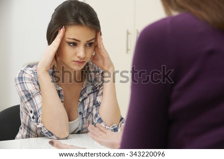 Teenage Girl Visiting Counsellor To Treat Depression - stock photo