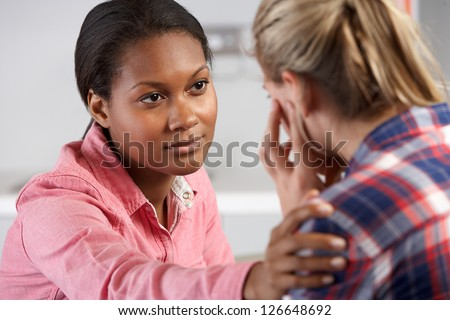 Teenage Girl Visits Doctor's Office Suffering With Depression - stock photo