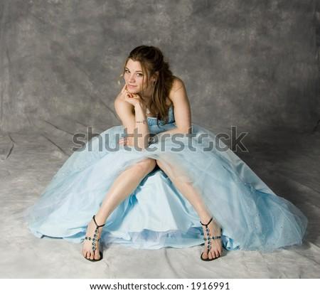 teenage girl wearing prom dress - stock photo