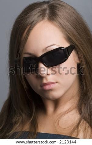 teenage girl wearing sunglasses - stock photo