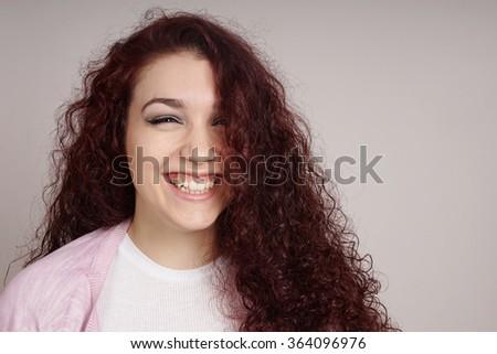 teenage girl with a big smile - stock photo