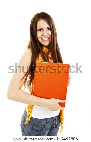 Teenage girl with a book. Isolated on a white background. - stock photo