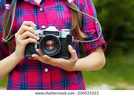 teenage girl with a camera. old photo camera. youth lifestyle - stock photo