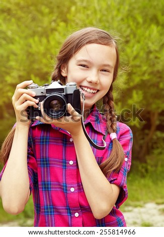teenage girl with a retro camera. old photo camera. youth lifestyle - stock photo