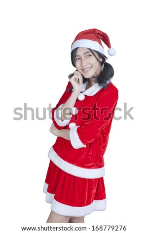 Teenage Girl with beautiful long curly hair. She is wearing a Santa hat.