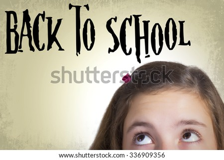 Teenage girl with bulging eyes looking at writing abowe him that says: Back to school. Expressing repulsion to school. Grunge background.  - stock photo