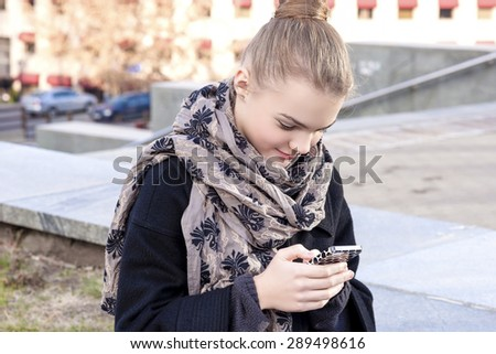 Teenage Girl with Cell Phone Outdoors. Horizontal Image Concept - stock photo