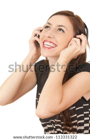 teenage girl with headphones looking up, white background - stock photo