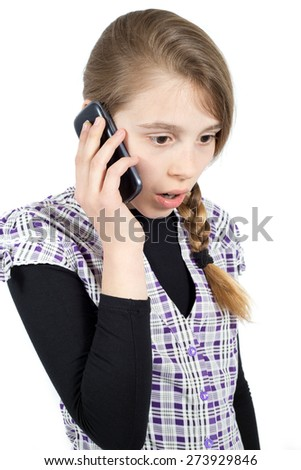 Teenage Girl With Her Mouth and Eyes Wide Open Expressing Surprise Emotion While Talking on Her Mobile Phone. Side View Studio Shot Isolated on White - stock photo