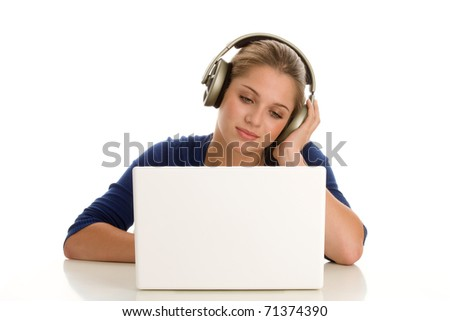 Teenage girl with laptop listening to music - stock photo