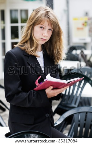 Teenage girl with personal organizer - stock photo