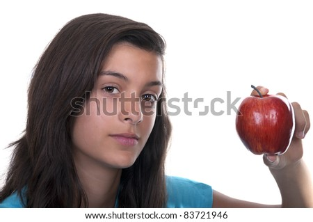 teenage girl with red apple on white background