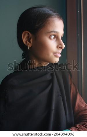 Teenage girl with window light - stock photo