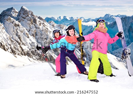 teenage girls and her mother in snow near Masserberg in Thuringia, Germany - stock photo