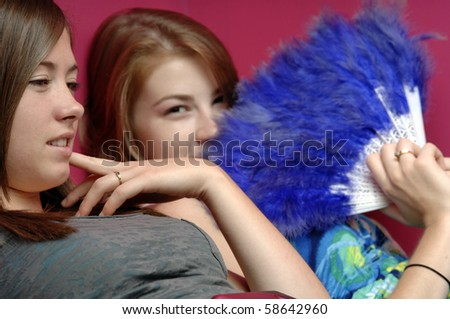 Teenage girls brows Internet on the laptop computer. - stock photo