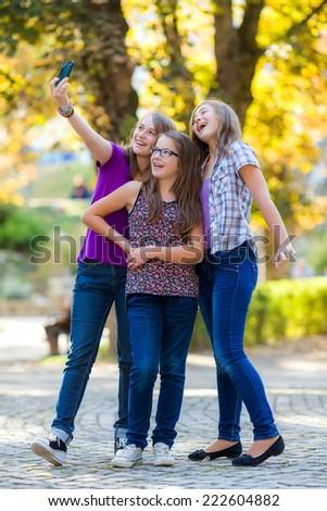 Teenage girls making selfie with mobile phone - stock photo