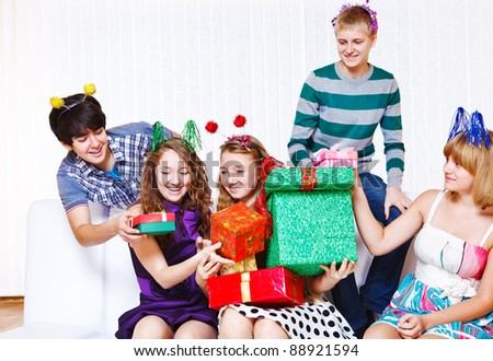 Teenage girls receiving holiday presents - stock photo