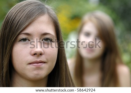 Teenage girls spend some time in the garden. - stock photo