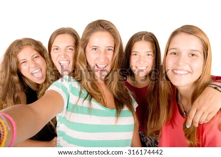 teenage girls taking selfies isolated in white background
