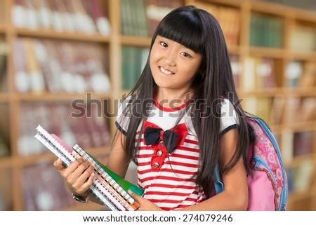 Teenage Girls. Teenage Schoolgirl Carrying Books and Backpack - stock photo