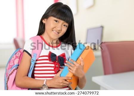 Teenage Girls. Teenage Schoolgirl with backpack and books on Campus - stock photo