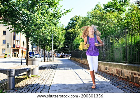 teenage girls waiting for the bus on the way to school - stock photo