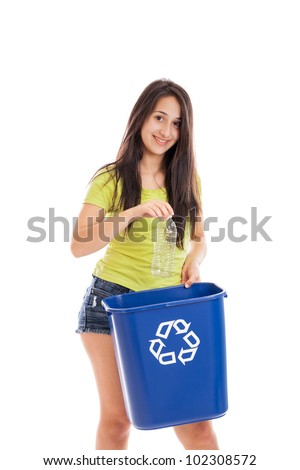 Teenage mixed race girl throwing plastic bottle in recycling bin isolated on white background - stock photo