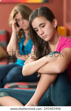 Teenage problems - Teenage girl with her sad and worried mother - stock photo