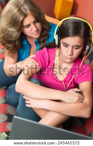 Teenage problems - Worried mother tries to comfort her sad teenage girl - stock photo