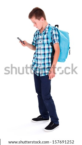 Teenage schoolboy in blue holding his telephone - isolated image - stock photo