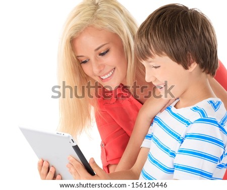 Teenage sister with young brother  - stock photo