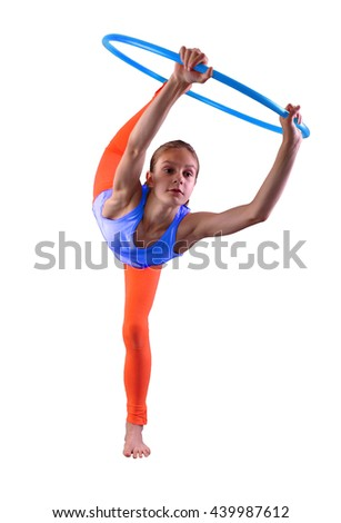 Teenage sportive girl is doing exercises with hula hoop on grey background. Having fun playing game hula-hoop. Isolated over white background. Teenager exercising with tool. - stock photo