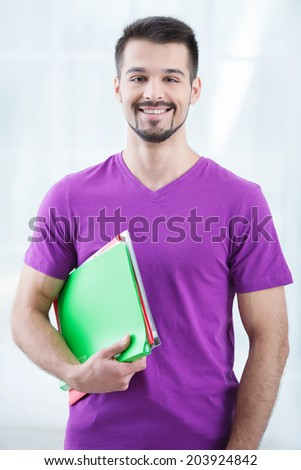 Teenage student with folders - stock photo